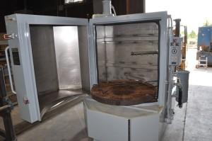 Parts washer clamshell door.